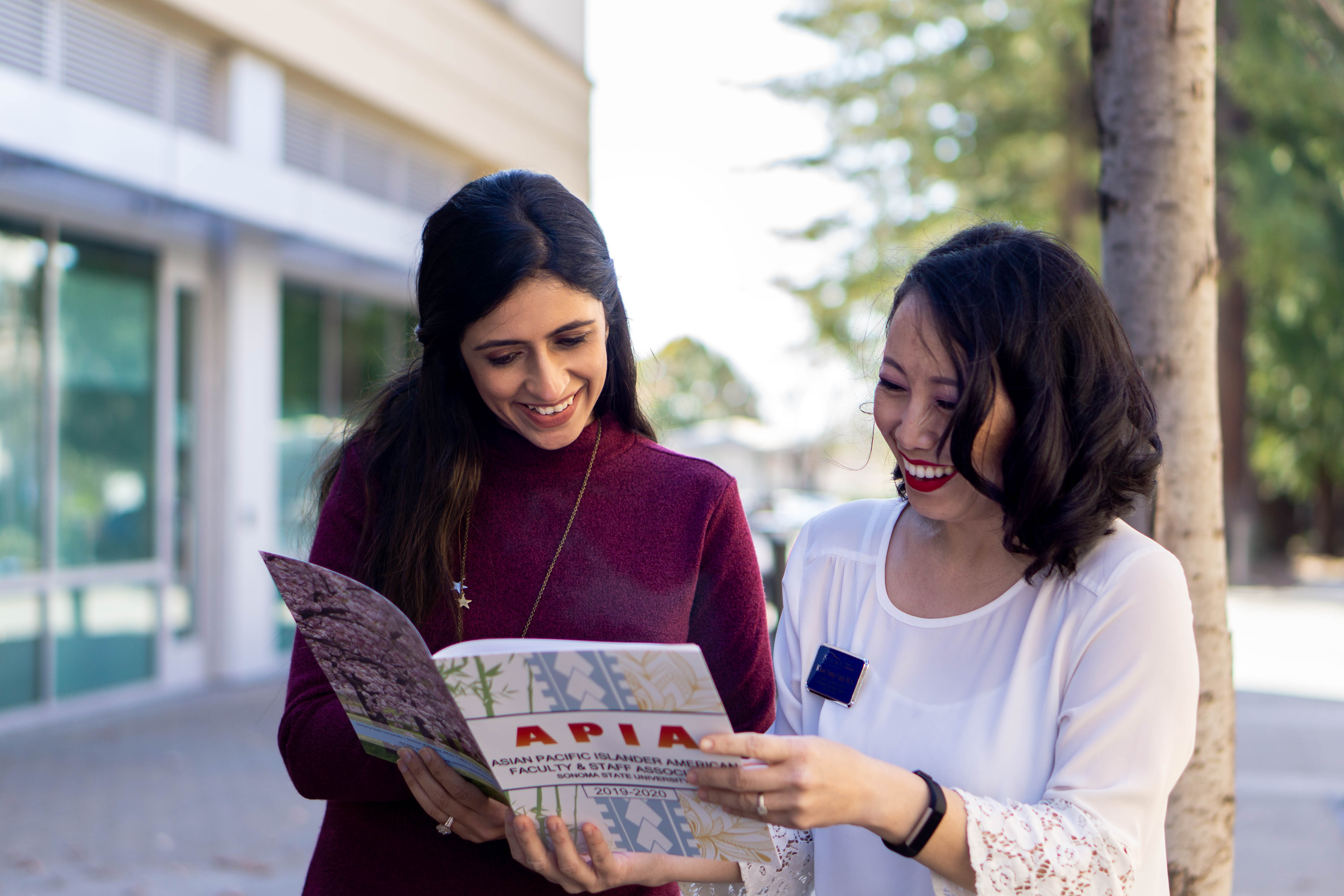 Two people sharing a magazine