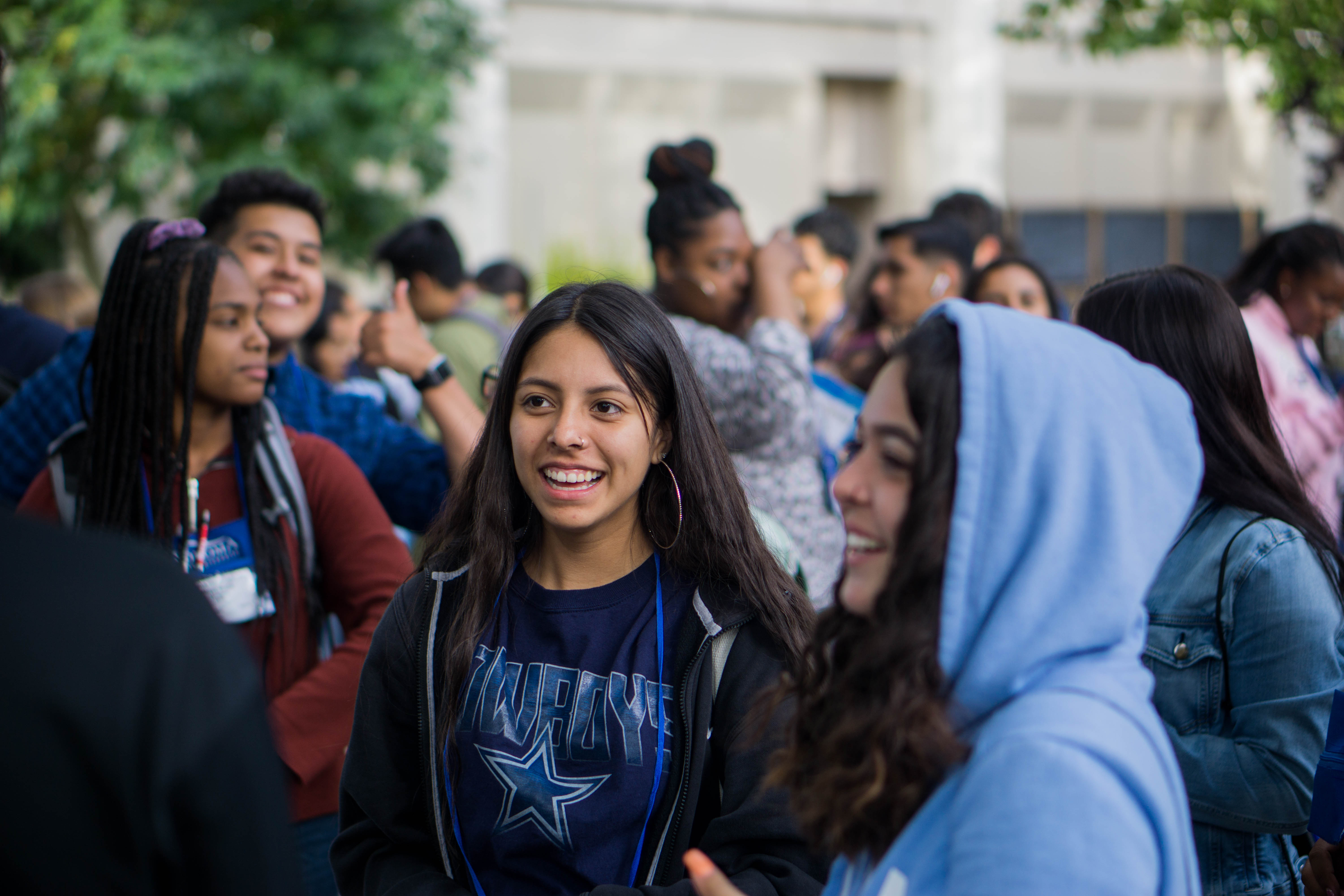 Students on campus, smiling