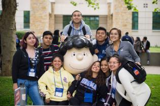 Group of students with Lucy statue